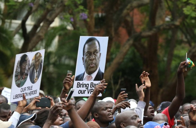 Protesters hold posters showing support for ousted Zimbabwean vice-President Emmerson Mnangagwa, in Harare, Zimbabwe, November 18, 2017. REUTERS/Philimon Bulawayo NO RESALES. NO ARCHIVES