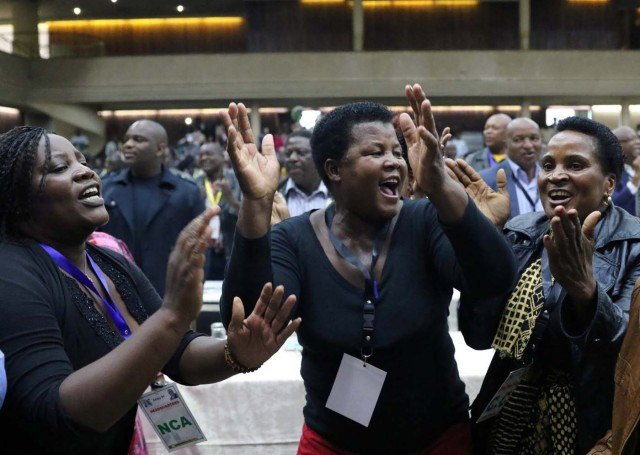 Delegates celebrate after Zimbabwean President Robert Mugabe was dismissed as party leader at an extraordinary meeting of the ruling ZANU-PF's central committee in Harare, Zimbabwe November 19, 2017. REUTERS/Philimon Bulawayo