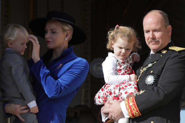 Prince Albert II of Monaco and his wife Princess Charlene hold their twins Prince Jacques and Princess Gabriella as they stand at the Palace Balcony during the celebrations marking Monaco's National Day, November 19, 2017.      REUTERS/Eric Gaillard