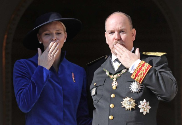 Prince Albert II of Monaco and his wife Princess Charlene blow a kiss from the Palace Balcony during the celebrations marking Monaco's National Day, November 19, 2017. REUTERS/Eric Gaillard