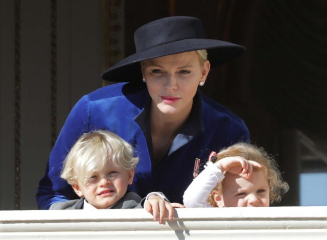 Princess Charlene and her twins Prince Jacques and Princess Gabriella stand at the Palace Balcony during the celebrations marking Monaco's National Day, November 19, 2017. REUTERS/Eric Gaillard