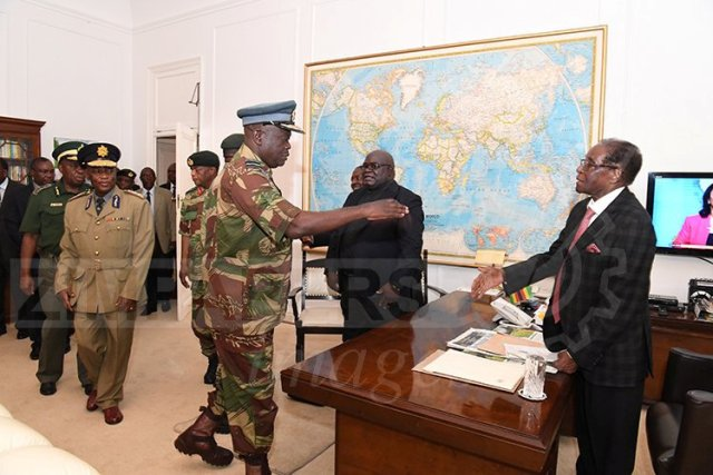 President Robert Mugabe meets with senior members of the Zimbabwe Defence Forces and police at State House in Harare, Zimbabwe November 19, 2017. ZIMPAPERS/Joseph Nyadzayo/Handout via REUTERS ATTENTION EDITORS - THIS IMAGE HAS BEEN SUPPLIED BY A THIRD PARTY. NO RESALES. NO ARCHIVES. ZIMBABWE OUT
