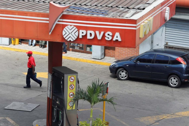 The corporate logo of the state oil company PDVSA is seen at a gas station in Caracas, Venezuela November 22, 2017. REUTERS/Marco Bello