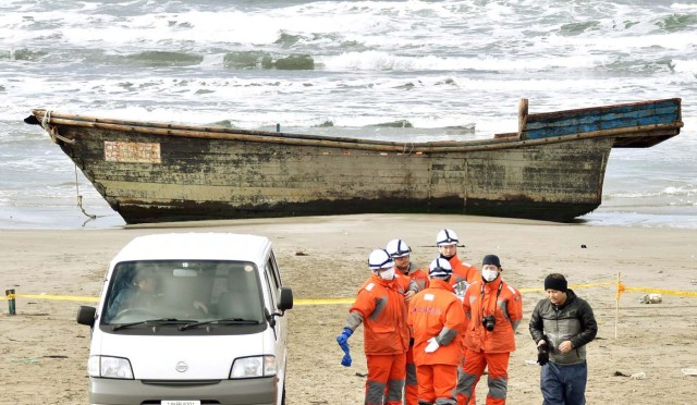 A wooden boat, which drifted ashore with eight partially skeletal bodies and was found by the Japan Coast Guard, is seen in Oga, Akita Prefecture, Japan, in this photo taken by Kyodo on November 27, 2017. Mandatory credit Kyodo/via REUTERS ATTENTION EDITORS - THIS IMAGE WAS PROVIDED BY A THIRD PARTY. MANDATORY CREDIT. JAPAN OUT. NO COMMERCIAL OR EDITORIAL SALES IN JAPAN.