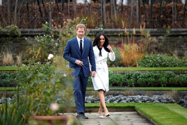 Britain's Prince Harry walks with Meghan Markle in the Sunken Garden of Kensington Palace, London, Britain, November 27, 2017. REUTERS/Toby Melville