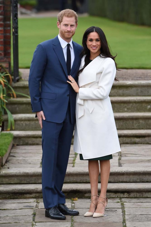Britain's Prince Harry poses with Meghan Markle in the Sunken Garden of Kensington Palace, London, Britain, November 27, 2017. REUTERS/Eddie Mulholland/Pool