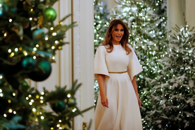 U.S. First Lady Melania Trump greets school children as she tours the holiday decorations with reporters at the White House in Washington, U.S. November 27, 2017.  REUTERS/Jonathan Ernst