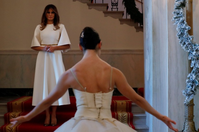 Ballerinas perform as U.S. First Lady Melania Trump begins a tour of the holiday decorations with reporters at the White House in Washington, U.S., November 27, 2017.  REUTERS/Jonathan Ernst