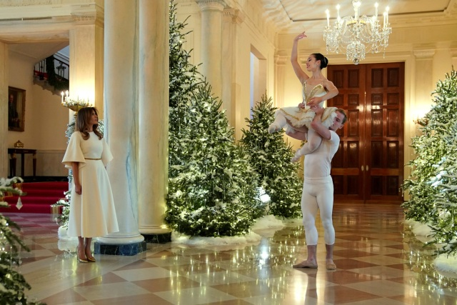 Ballet dancers perform as U.S. first lady Melania Trump begins a tour of the holiday decorations with reporters at the White House in Washington, U.S., November 27, 2017. REUTERS/Jonathan Ernst