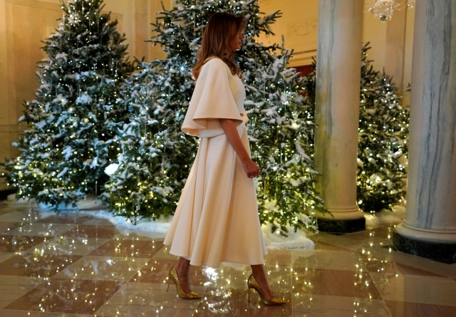 U.S. First Lady Melania Trump greets schoolchildren (not pictured) as she tours the holiday decorations with reporters at the White House in Washington, U.S., November 27, 2017. REUTERS/Jonathan Ernst