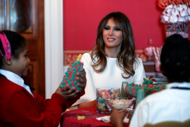 U.S. First Lady Melania Trump greets schoolchildren as she tours the holiday decorations with reporters at the White House in Washington, U.S., November 27, 2017.  REUTERS/Jonathan Ernst