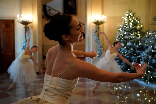Ballerinas perform before U.S. First Lady Melania Trump (not pictured) begins a tour of the holiday decorations with reporters at the White House in Washington, U.S. November 27, 2017.  REUTERS/Jonathan Ernst