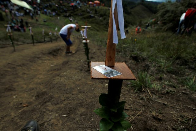 People pay tribute on the first anniversary of the plane crash where several players of the Chapecoense soccer team died, in La Union, Colombia November 28, 2017. REUTERS/Fredy Builes