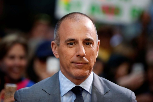 """FILE PHOTO: Host Matt Lauer pauses during a break while filming NBC's """"Today"""" show at Rockefeller Center in New York, U.S., May 3, 2013. REUTERS/Lucas Jackson/File Photo"""