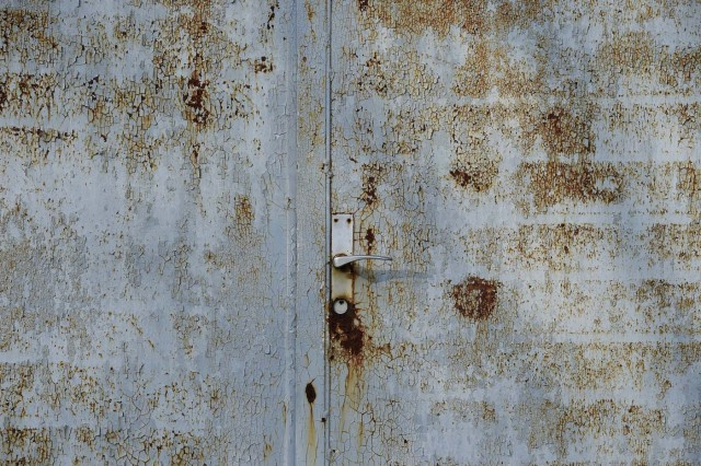 A door of a house is pictured in Alwine, a splinter settlement of the town Uebigau-Wahrenbrueck, eastern Germany, on November 30, 2017. On December 9, 2017, Alwine's dozen buildings, plus sheds and garages, are to go under the hammer at an auction in Berlin, with a starting price of 125,000 euros ($148,000). / AFP PHOTO / Tobias Schwarz