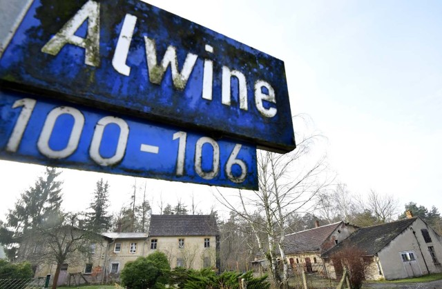A street sign of Alwine, a splinter settlement of the town Uebigau-Wahrenbrueck, eastern Germany, is pictured on November 30, 2017. On Saturday, Alwine's dozen buildings, plus sheds and garages, are to go under the hammer at an auction in Berlin, with a starting price of 125,000 euros ($148,000). / AFP PHOTO / Tobias Schwarz
