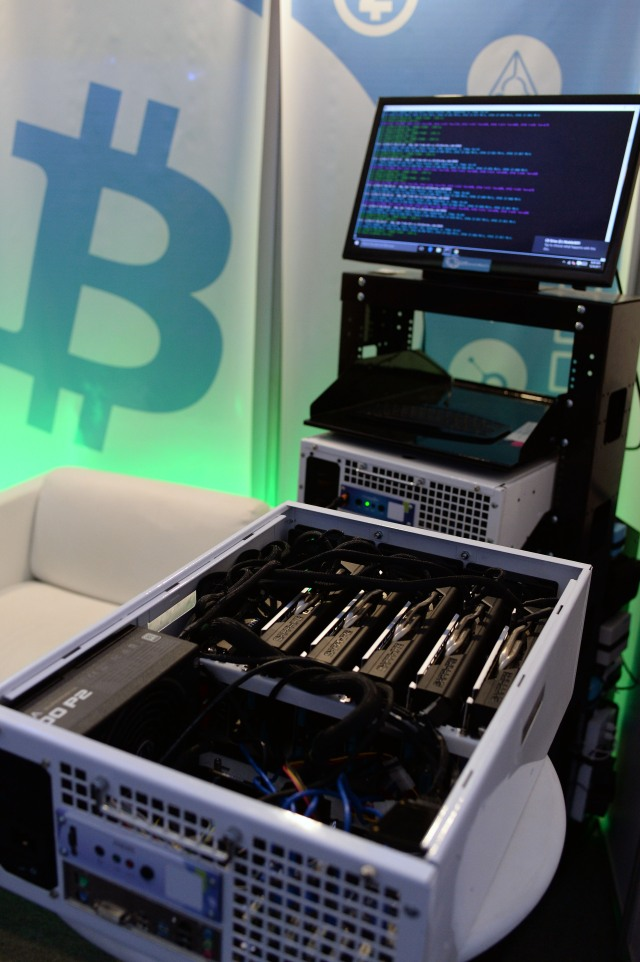 This picture shows a data miner's machine used to create Ethereum (virtual currency), at the International Science and Technology Fair (FITEC) in Caracas on December 4, 2017. Venezuela is creating a digital currency to combat a financial blockade by the United States, President Nicolas Maduro announced Sunday. / AFP PHOTO / FEDERICO PARRA