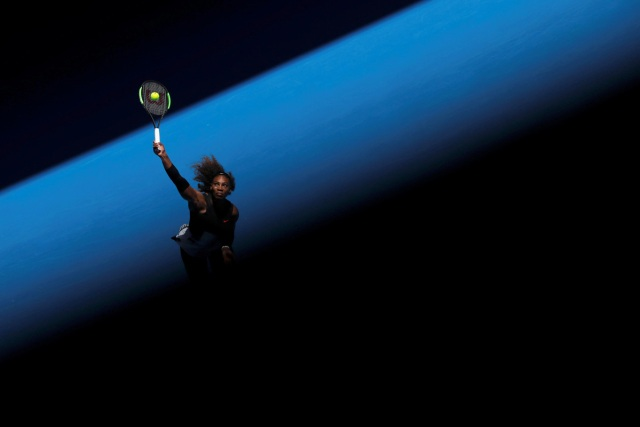 "Serena Williams of the U.S. serves during her Women's singles third round match against Nicole Gibbs of the U.S. during the Australian Open at Melbourne Park in Melbourne, Australia, January 21, 2017. REUTERS/Jason Reed/File Photo  SEARCH ""POY SPORT"" FOR THIS STORY. SEARCH ""REUTERS POY"" FOR ALL BEST OF 2017 PACKAGES.    TPX IMAGES OF THE DAY"
