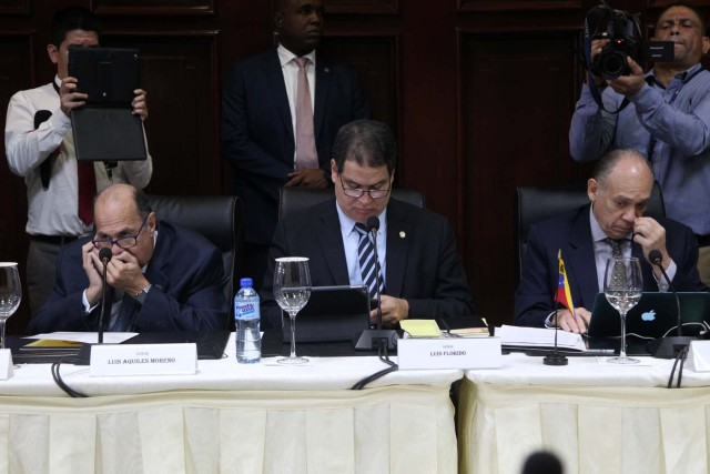 Members of Venezuela's opposition Luis Aquiles Moreno, Luis Florido and Gustavo Velazquez attend a meeting between Venezuela's government and opposition coalition in Santo Domingo, Dominican Republic, December 2, 2017. REUTERS/Ricardo Rojas