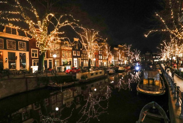 Trees are illuminated near a canal in central Amsterdam, Netherlands, November 30, 2017. Picture taken November 30, 2017. REUTERS/Yves Herman