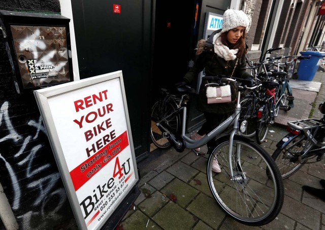 A tourist rents a bicycle in central Amsterdam, Netherlands, December 1, 2017. REUTERS/Yves Herman