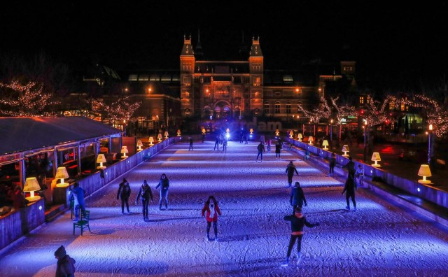 People skate on a temporary ice rink outside the Rijksmuseum in Amsterdam, Netherlands, November 30, 2017. Picture taken November 30, 2017. REUTERS/Yves Herman