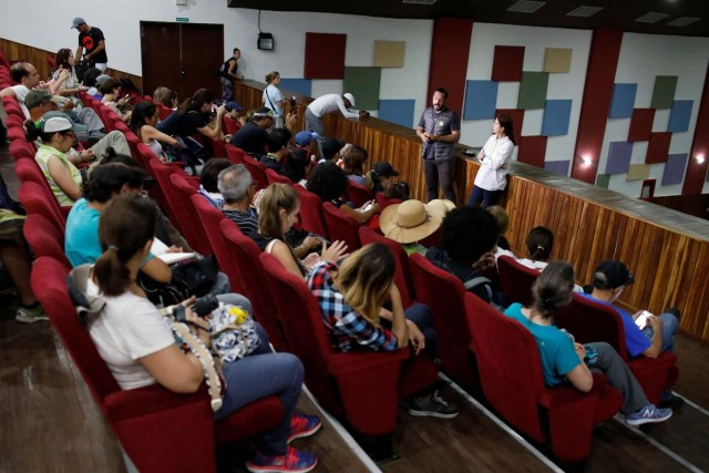Luis Bergolla (standing C), tour organizer of 'Caracas in 365', speaks to attendees inside the Catia Theater during a walking tour at Catia neighborhood in Caracas, Venezuela November 18, 2017. Picture taken November 18, 2017. REUTERS/Marco Bello