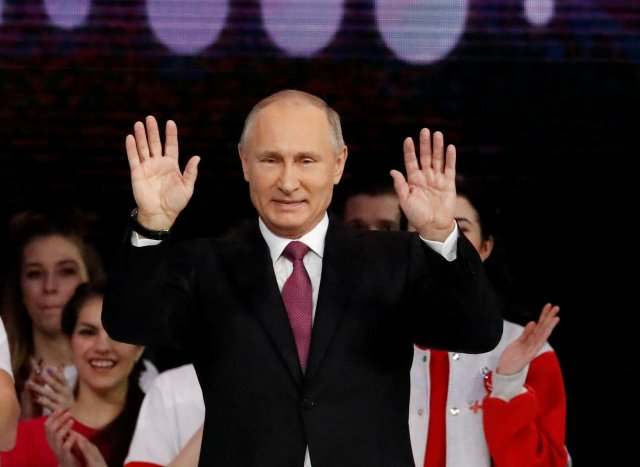 Russian President Vladimir Putin greets the audience at the congress of volunteers in Moscow, Russia December 6, 2017. REUTERS/Sergei Karpukhin