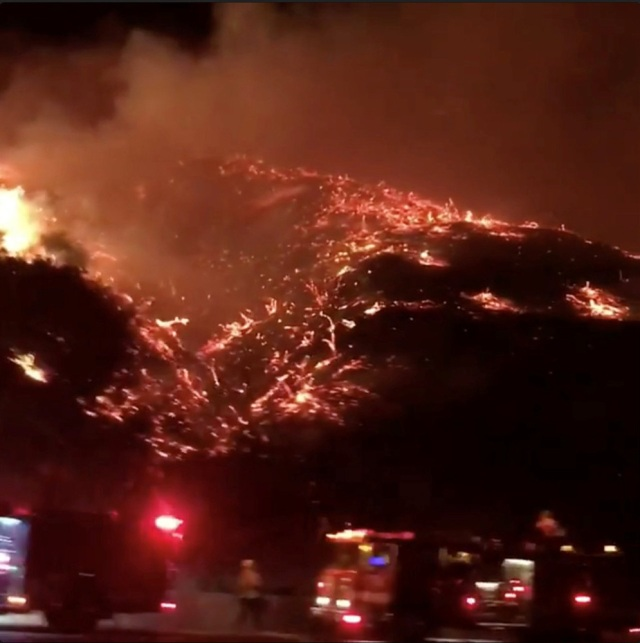 A wildfire burns in 405 highway in Los Angeles, California, U.S., December 6, 2017 in this picture obtained from social media. Instagram/Bethany Ellis/Handout via REUTERS ATTENTION EDITORS - THIS IMAGE WAS PROVIDED BY A THIRD PARTY. MANDATORY CREDIT. NO RESALES. NO ARCHIVE