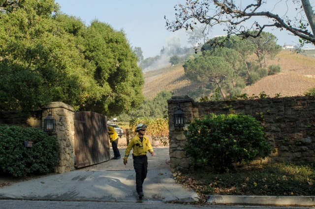A firefighter walks out of a vineyard owned by Rupert Murdoch damaged by the Skirball fire near the Bel Air neighborhood on the west side of Los Angeles, California, U.S., December 6, 2017.      REUTERS/Andrew Cullen