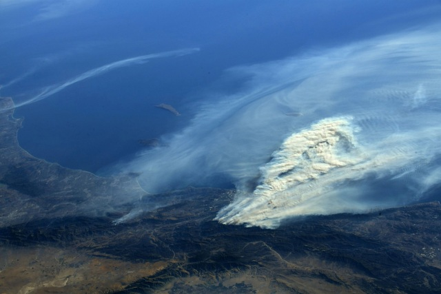 A photo taken from the International Space Station and moved on social media by astronaut Randy Bresnik shows smoke rising from wildfire burning in Southern California, U.S., December 6, 2017.  Courtesy @AstroKomrade/NASA/Handout via REUTERS   ATTENTION EDITORS - THIS IMAGE HAS BEEN SUPPLIED BY A THIRD PARTY.
