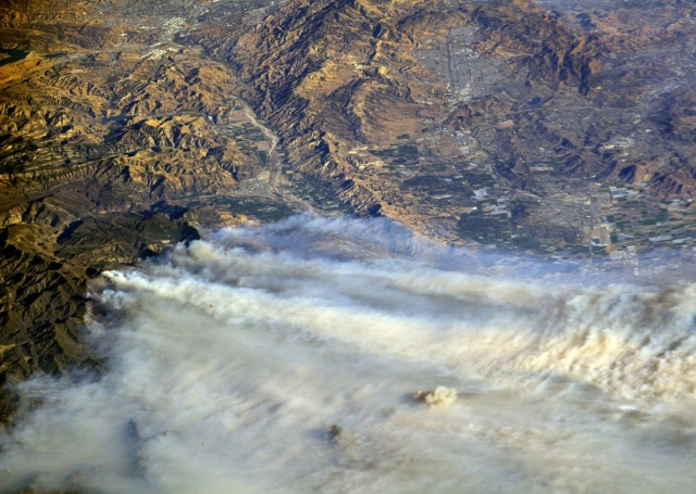 A photo taken from the International Space Station and moved on social media by astronaut Randy Bresnik shows smoke rising from wildfire burning in Southern California, U.S., December 6, 2017.  Courtesy @AstroKomrade/NASA/Handout via REUTERS   ATTENTION EDITORS - THIS IMAGE HAS BEEN SUPPLIED BY A THIRD PARTY.     TPX IMAGES OF THE DAY