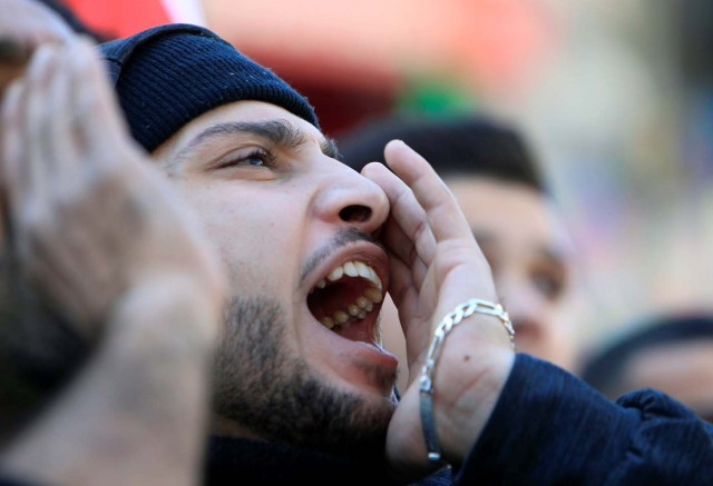 "A demonstrator shouts slogans during a protest as Palestinians call for a ""day of rage"" in response to U.S. President Donald Trump's recognition of Jerusalem as Israel's capital, in the West Bank city of Nablus, December 8, 2017. REUTERS/Abed Omar Qusini"