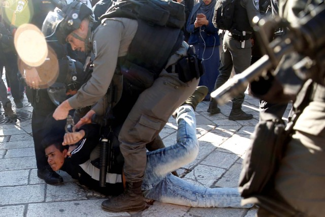 "Israeli border policemen detain a Palestinian man during scuffles at Damascus Gate after Friday prayers in Jerusalem's Old City, as Palestinians call for a ""day of rage"" in response to U.S. President Donald Trump's recognition of Jerusalem as Israel's capital December 8, 2017. REUTERS/Ronen Zvulun"