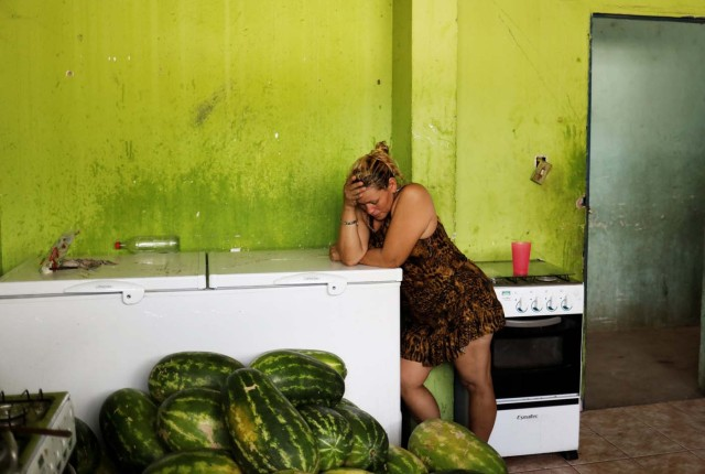 "A Venezuelan woman stands in a kitchen of a gym which has turned into a shelter for Venezuelans and is run by Civil Defense with meals provided by Evangelical churches in Caimbe neighbourhood in Boa Vista, Roraima state, Brazil November 17, 2017. REUTERS/Nacho Doce SEARCH ""VENEZUELAN MIGRANTS"" FOR THIS STORY. SEARCH ""WIDER IMAGE"" FOR ALL STORIES. TPX IMAGES OF THE DAY"