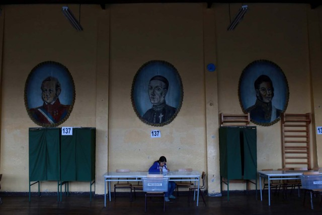 An elections officer waits inside a polling station during the presidential election at Santiago, Chile December 17, 2017. REUTERS/Pablo Sanhueza