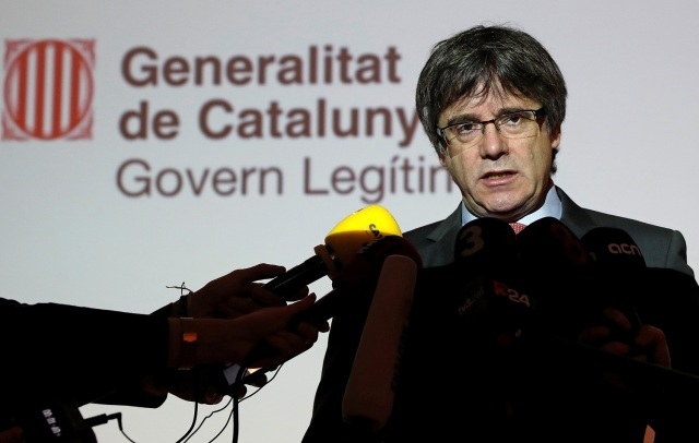Catalonia's former President Carles Puigdemont speaks during a news conference in Brussels, Belgium, December 21, 2017. REUTERS/Yves Herman