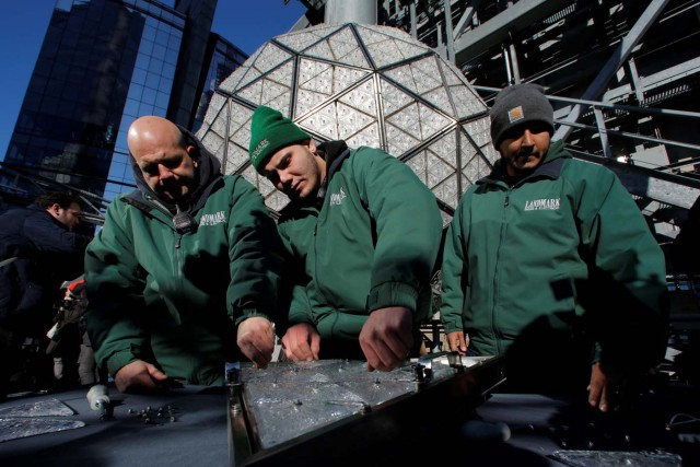 Workers prepare a panel of Waterford Crystal triangles before attaching it to the Times Square New Year's Eve Ball on the roof of One Times Square in Manhattan, New York, U.S., December 27, 2017. REUTERS/Andrew Kelly