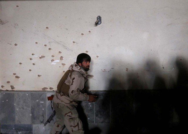 An Afghan security force inspects bullet holes at the site of a suicide attack in Kabul, Afghanistan December 28, 2017. REUTERS/Omar Sobhani