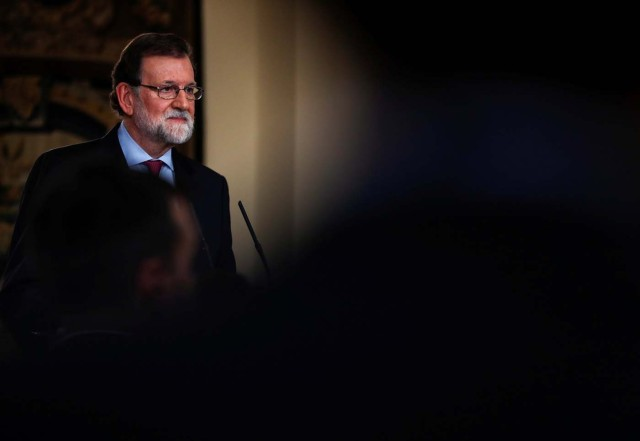 Spain's Prime Minister Mariano Rajoy listens to a questions after delivering his year-end speech at the Moncloa Palace in Madrid, Spain, December 29, 2017. REUTERS/Juan Medina
