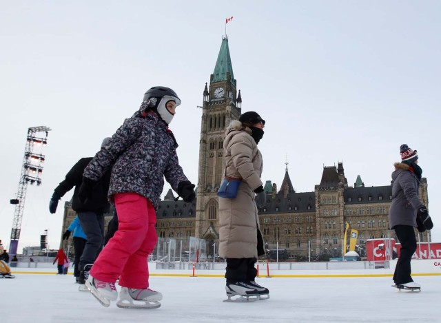 People brave the frigid weather to skate on an outdoor rink on Parliament Hill in Ottawa, Ontario, Canada, December 29, 2017. REUTERS/Patrick Doyle