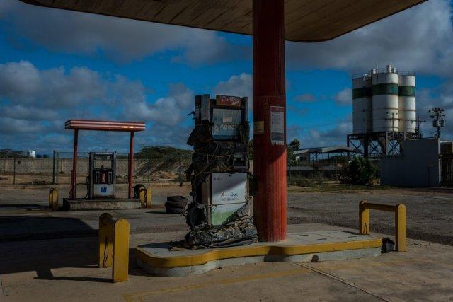 Una bomba fuera de servicio en una estación de PDVSA en Paraguaná Credit Meridith Kohut para The New York Times