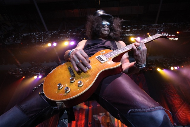 "(FILES) This file photo taken on July 29, 2010 shows British-born guitarist Slash performing in Hong Kong. The two-decades-in-the-making reunion of Guns N' Roses has become the fourth highest-earning tour in history, grossing $475 million, Billboard reported on January 4, 2018.The music industry magazine and chart-keeper, releasing its year-end calculations of concert receipts, said that Guns N' Roses had surpassed former Pink Floyd member Roger Waters' marathon 2010-13 ""The Wall Live"" tour.  / AFP PHOTO / Ed JONES"