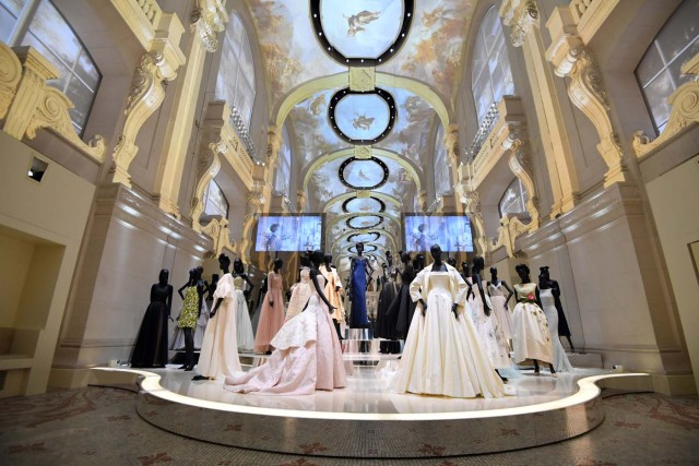 (FILES) This file picture taken on July 3, 2017 shows dresses exhibited during the Dior exhibition that celebrates the seventieth anniversary of the Christian Dior fashion house at the Museum of Decorative Arts (Musee des Arts Decoratifs) in Paris. 708 000 people visited the exhibition dedicated to Christian Dior from July 5, 2017 to January 7, 2018 in Paris. / AFP PHOTO / ALAIN JOCARD