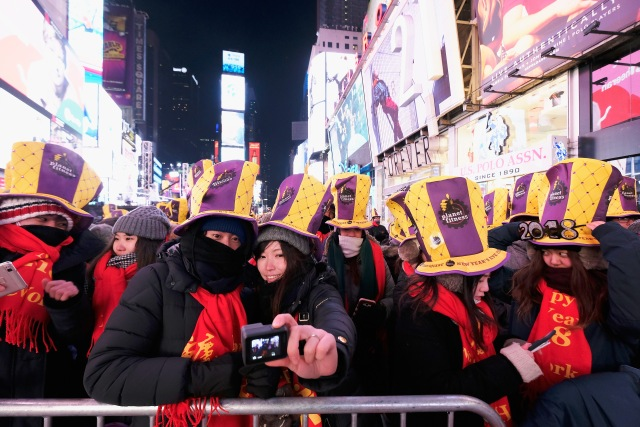NEW YORK, NY - DECEMBER 31: A general view of atmosphere during New Year's Eve 2018 in Times Square on December 31, 2017 in New York City. Dimitrios Kambouris/Getty Images/AFP
