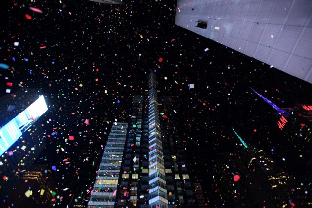 Confetti falls in Times Square just after midnight during New Year celebrations in Manhattan, New York, U.S., January 1, 2018. REUTERS/Darren Ornitz