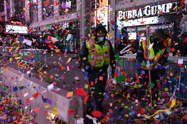 NYC sanitation workers clean up confetti following New Year celebrations in Times Square in Manhattan, New York, U.S., January 1, 2018. REUTERS/Darren Ornitz