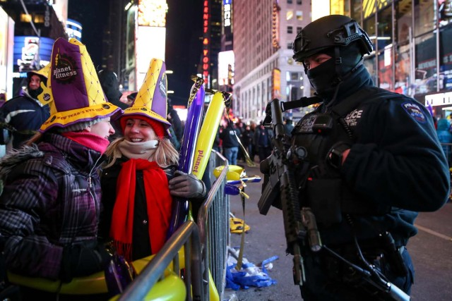 A New York Police Department (NYPD) Emergency Unit officer stands guard in Times Square during the New Year's Eve celebrations in Manhattan, New York, U.S., December 31, 2017. Picture taken December 31, 2017. REUTERS/Amr Alfiky