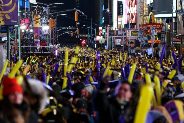 Revelers gather in Times Square during the New Year's Eve celebrations in Manhattan, New York, U.S., December 31, 2017. Picture taken December 31, 2017. REUTERS/Amr Alfiky