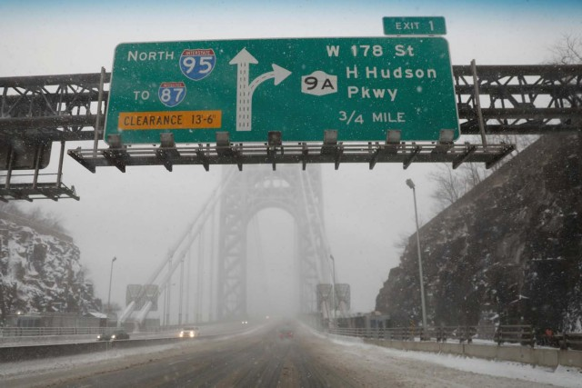 A nearly empty snow-covered roadway entrance to the George Washington Bridge between New Jersey and New York is seen during a snowstorm in Fort Lee, New Jersey, U.S., January 4, 2018. REUTERS/Mike Segar
